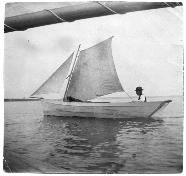 Chester Fuller and dog aboard the 'Chesperus,' 1898