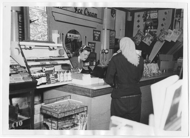 Flora Kite scoops ice cream at Jordan's, around 1940