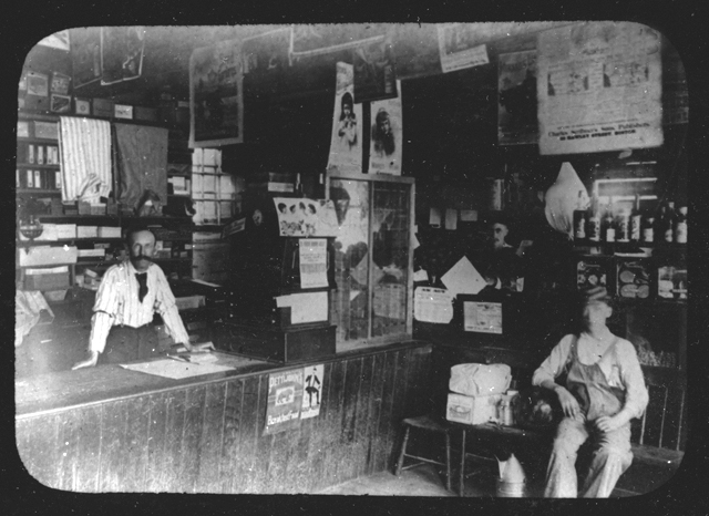 Proprietor and clerks at the Old Country Store, circa 1900