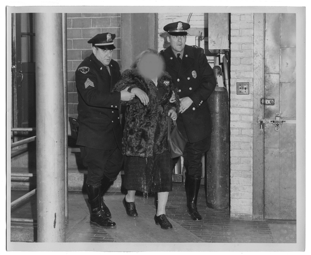 Sergeant Arthur Moskos and Chief James Goonan with an unknown woman, Plymouth Police Station, circa 1950