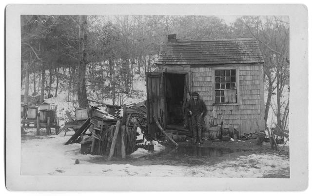 Dan Fuller the Hermit in front of his hut, 1893
