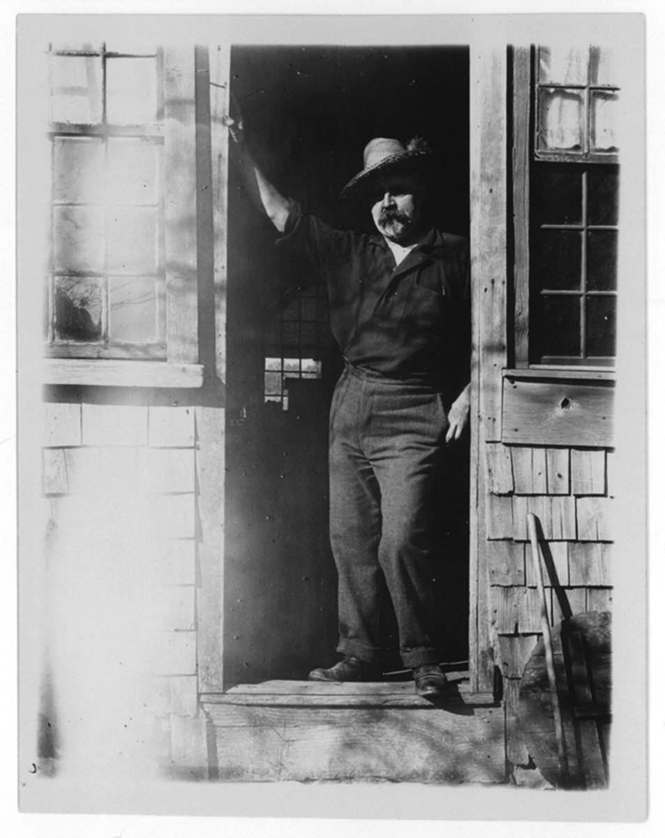 Eben Plimpton in doorway at Silver Lake, no date