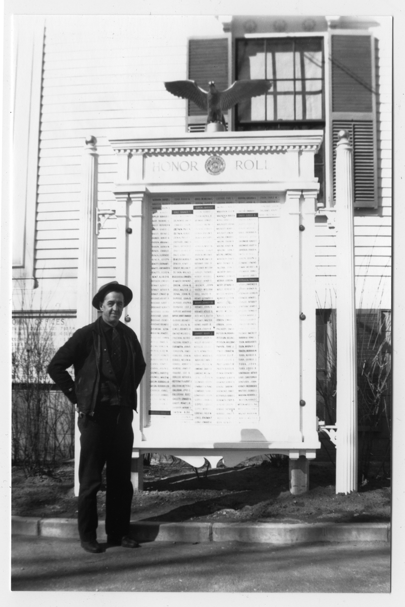 G. Palmer Holmes and the World War II Honor Roll outside Town Hall, circa1946