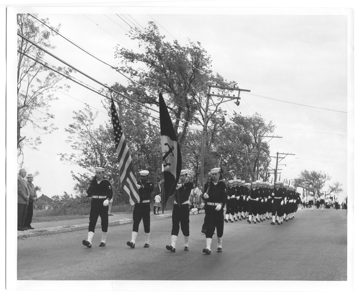 Sailors from the U.S.S. Des Moines march on Main Street