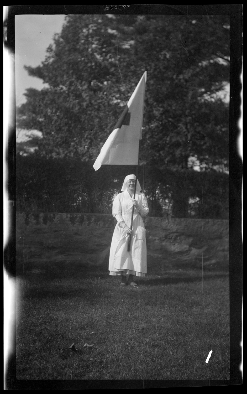 Marcher with Red Cross flag in the Welcome Home parade, October 18, 1919.